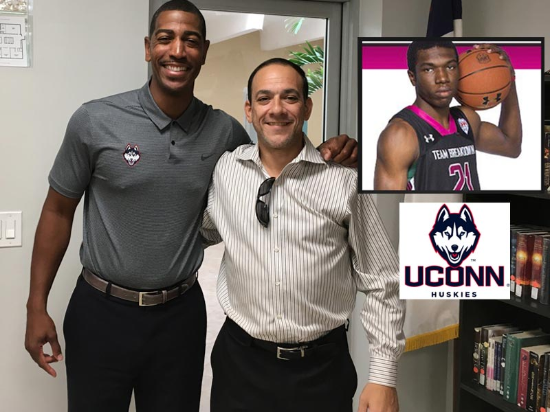 Coach Kevin Ollie of UConn meets with Coach Jose Amat